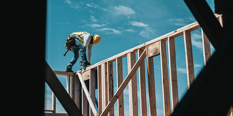 construction worker on wood beam project