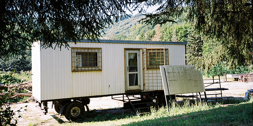 mobile home on grassy field